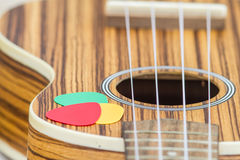 Pick on ukulele sideboard. Royalty Free Stock Photo