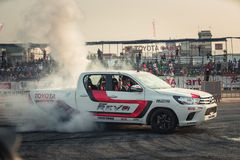 Pick-up car perform burnout tire on the track Stock Images