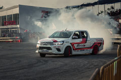 Pick-up car perform drifting with smoke Stock Photo