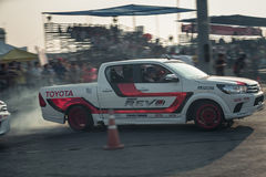 Pick-up car perform drifting on the track with motion blur Stock Image
