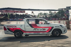 Pick-up car perform drifting on the track with motion blur Royalty Free Stock Photo