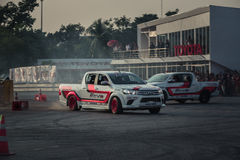 Pick-up car perform drifting on the track with motion blur Stock Photo
