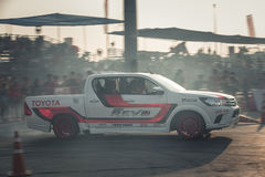 Pick-up car perform drifting on the track with motion blur Stock Photos