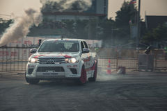Pick-up car perform drifting on the track with motion blur Stock Images