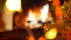 Pick up a gift. Christmas gift box. Christmas three on glow fireplace bokeh lights background stock footage