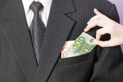 Pick up the money from pocket Stock Photography