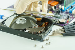 pick up and open hard disk drive for repair inside Stock Images