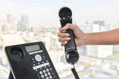 Pick up the phone call with hand set Stock Photos