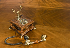 Pick up the phone. Old-fashioned telephone. On the table stock photo