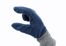 Pick up with polar glove. Hand with polar glove making the symbol of pick up on white background Stock Photography