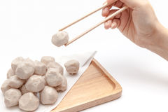 Pick up pork ball by chopsticks on white background isolated Royalty Free Stock Images