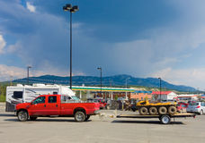 A pick-up pulling a specialized  atv at whitehorse Stock Photo