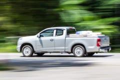 Pick-up Speeding in road Stock Photos