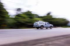 Pick-up Speeding in road Stock Images