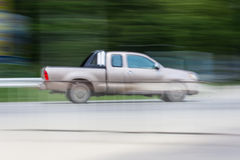Pick-up Speeding in road Stock Photo