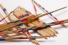 Pick up a stick. Watch out,  that no sticks are moving Stock Images
