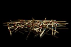 Pick-up sticks in black sorroundings Royalty Free Stock Photography