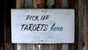 Pick up Targets Here Sign Stock Images