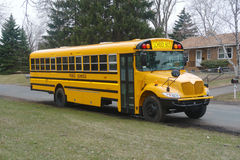 Pick up time. A picture of a school bus waiting to pick up children Stock Images