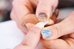 Pick up tips. French manicure stock photography