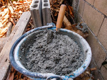 Pick up a trowel and cement mix concrete Royalty Free Stock Photography