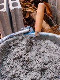 Pick up a trowel and cement mix concrete Stock Images