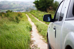 Pick-up truck with grassland on the sideways Royalty Free Stock Images