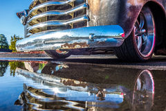Pick up truck and its grille reflecting in puddle Royalty Free Stock Photo