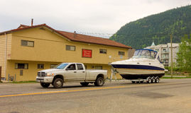 A pick-up truck pulling a boat in british columbia. A resident of harrison hot springs getting ready for the boating season stock photos