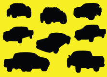 Pick-up trucks silhouettes. Isolated on yellow background Stock Photo