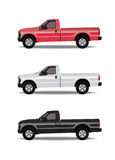 Pick-up trucks in three colors. Red, white and black Stock Photography