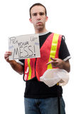 Pick Up Your Mess. Garbage volunteer worker holding a sign that says pick up your mess, isolated against a white background Royalty Free Stock Photo