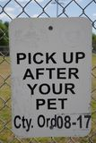 Tampa, Florida / USA - May 5 2018: Pick Up After Your Pet Sign stock image