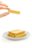 Picked wafer. Hand pick a wafer on white background Royalty Free Stock Photography