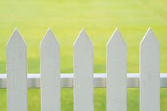 Picket Fence. A picket fence with a green lawn as a background Stock Images
