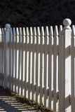 Picket Fence. An old-fashioned white picket fence Stock Image