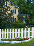Picket Fence. A white picket fence surrounds a country home located in rural North Wester, New Jersey Royalty Free Stock Photo