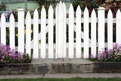 Picket Fence. A picket fence gate with surrounding flowers Stock Photography