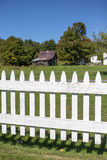 Picket fence with barn Stock Photo