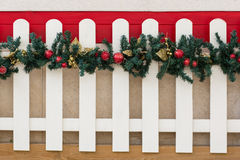 Picket Fence and Christmas Decorations Royalty Free Stock Images
