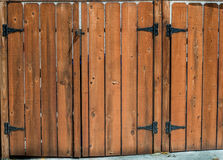 Picket fence. Dog-ear shaped picket fence and gate and hinges Stock Images