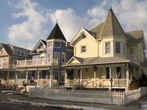 Picket Fence and Victorian Homes. This is a couple of colorful victorian homes in Ocean Grove NJ royalty free stock image