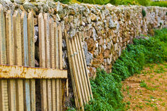 Picket fences and stone wall, Malta Stock Photo