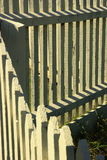 Picket Fencing. A close up of a picket fence an gate with shadows Stock Images