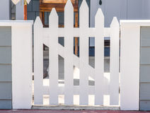 Picket gate. Nice new white closed fence gate with z-frame and convex shape Royalty Free Stock Images