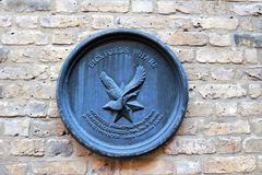Pickfords Wharf emblem marking the location along the River Thames in London. Pickfords Wharf emblem on a brick wall marking the location along the River Thames stock photography