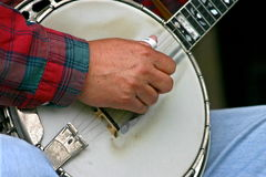 Picking the banjo. Closeup of mans hands picking the banjo royalty free stock photos