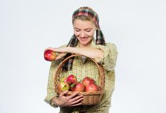 Picking best one. organic vegetarian. healthy teeth. Happy woman eating apple. orchard, gardener girl with apple basket royalty free stock photography