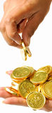 Picking the coins. Picking the gold coins over isolated background Royalty Free Stock Photo