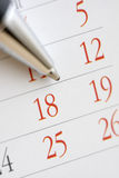 Picking a day. Planning future tasks on a calendar using a ballpoint pen Stock Photography